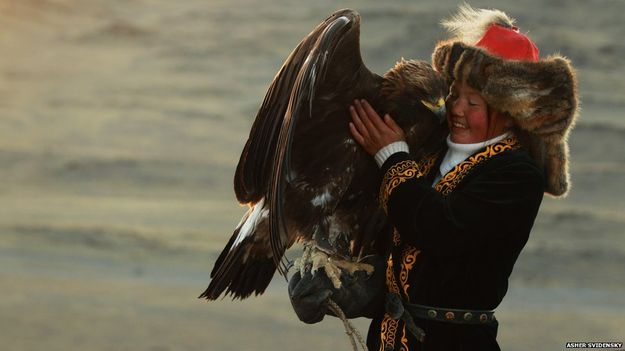 Ashol Pan, petting her eagle, a mighty girl. Photo Credit: Asher Svidensky